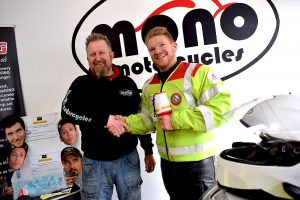 mono motorcycles & vehicle security Proprietor Daniel Morris handing over £70 raised in the mono raffle to Serv Wessex Blood Bike volunteer Rich Hobden