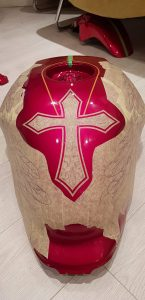 The cross developed by first creating a outer design using pin striping tape.