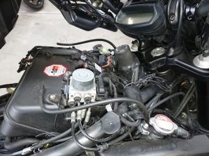 She has returned to us after having a fault code cleared twice for a 'Horizontal Map Sensor' The sensor has now been replaced & the fault code cleared. To get to the sensor, the Diavel had to have her seat, tank & handle bars removed, as the sensor was hidden just behind the frame, under the tank.