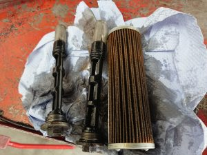 An initial investigation of the KTM, showed the oil filters had crumpled & filings in the oil indicate low pressure. Daniel also discovered that a spring which sits below the oil filter was missing.