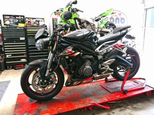 On Thursday Daniel managed to take a moment to attend to the Triumph 765 RS