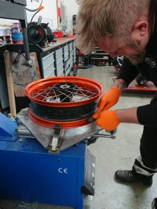 Cleaning the wheel rims, prior to fitting of the new tyres & removing old rubber from the wheel rim; ensures a perfect seal & prevents leaking
