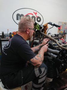 Often times seemingly connected to the beautiful motorcycles he has the pleasure of working with, we now call him the 'Wiring Whisperer'