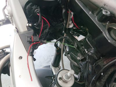 Having finally got the BMW stripped to a point where he could gain access to the wiring loom & chasing cabling; he found the cause of the intermittent cutting out fault, whereby water had got into the wiring loom & caused the power wire to the ignition switch to become brittle & had broken in two places.