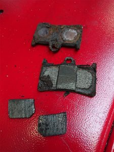 These brake pads show extreme wear & tear & could impact on the motorcycles performance.